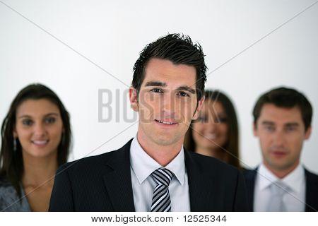 Portrait of businessman with work team