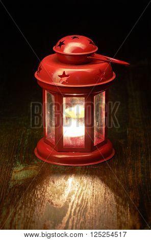 Lantern candel lamp, on wooden background