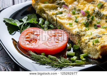 sliced tomato and scrambled eggs on a black background