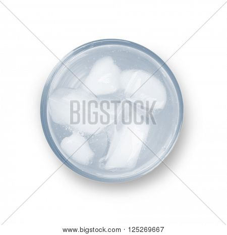 Glass of water with ice blocks isolated on white background, top view