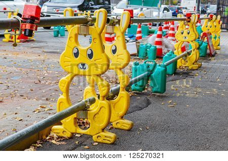 KYOT JAPAN - NOVEMBER 22 2015: Row of Japanese construction barrier designed in cute cartoon character