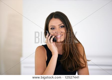 Portrait of a smiling woman telephoning with a cell phone