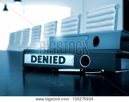 Denied - Business Concept on Toned Background. Denied. Illustration on Blurred Background. Denied - Ring Binder on Wooden Desk. Office Folder with Inscription Denied on Wooden Desktop. 3D Toned Image.