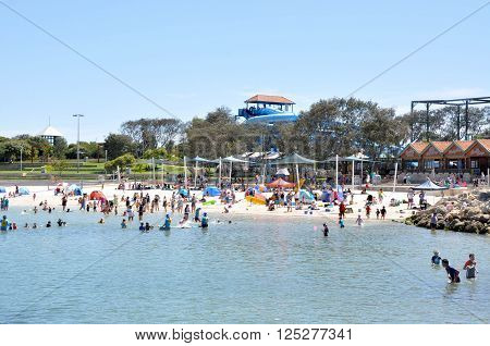 HILLARYS,WA,AUSTRALIA-JANUARY 22,2016: Beach recreation with families in the swimming cove at Hillarys Boat Harbour, in Hillarys, Western Australia.