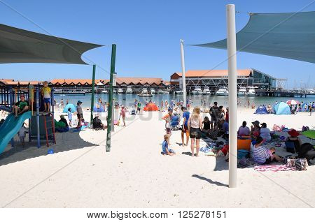 HILLARYS,WA,AUSTRALIA-JANUARY 22,2016: Beach vacation with families, playground, marina and swimming cove at Hillarys Boat Harbour, in Hillarys, Western Australia.