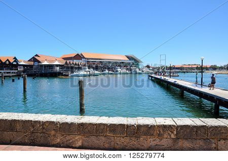 HILLARYS,WA,AUSTRALIA-JANUARY 22,2016: Swimming cove with jetty and tourists at the marina at Hillarys Boat Harbour in Hillarys, Western Australia.