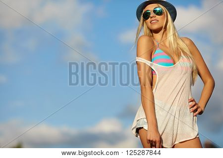 Beautiful joyful blond woman sunbathing at the seaside