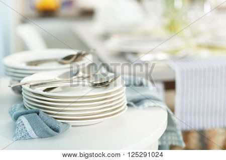 Stacked plates with flatware, close up