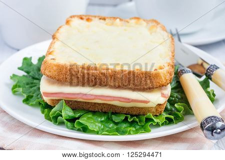 French toasted sandwich Croque monsieur oa a plate, closeup