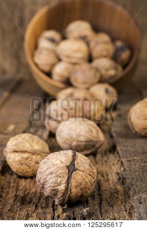 Walnuts close-up with shallow depth of field on a background of an old board