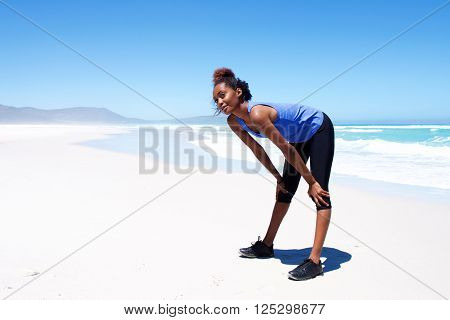 Woman Taking A Break During Workout On The Beach