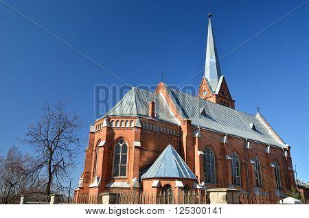 Red brick gothic catholic church in Daugavpils, Latvia poster