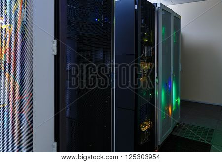 room with rows of modern server hardware in the data center