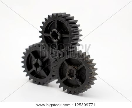 picture of a black old plastic dirty cogwheel