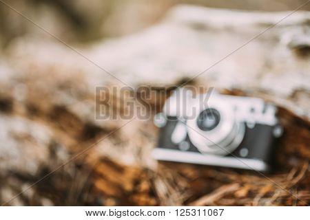 Abstract Blurred Background Of Old Vintage Rangefinder Camera In Forest
