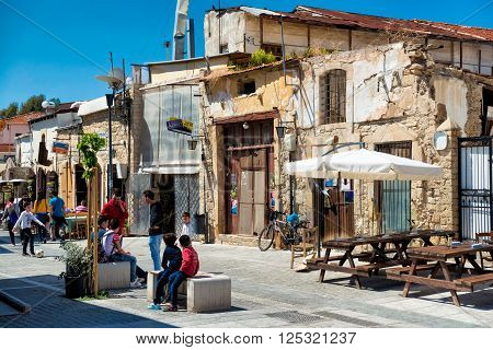 LIMASSOL CYPRUS - April 01 2016: People at the square near The Great Mosque (Cami Kebir).