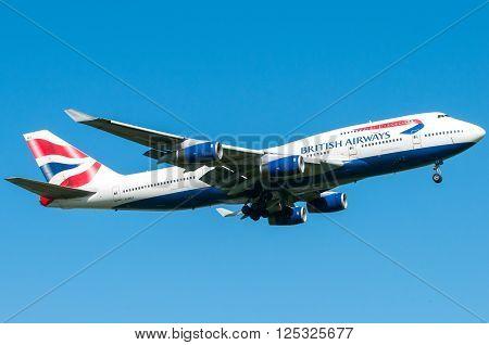 London UK April 9 2011: 4-engines Boeing 747 of British Airways carrier landing at Heathrow airport.