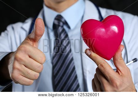Male Medicine Doctor In Hold Red Toy Heart And Show Ok