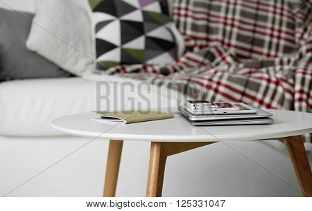 Pile of electronic gadgets on the table. Communication and technology concept poster