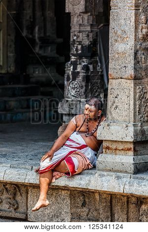 KANCHIPURAM, INDIA - SEPTEMBER 12, 2009: Unidentified temple brahmin in Ekambareswarar Temple, Kanchipuram. The city is a holy pilgrimage site for Hinduists