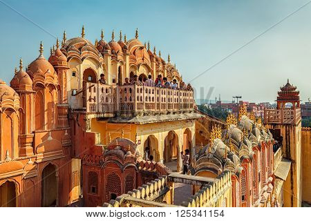 JAIPUR, INDIA - NOVEMBER 18, 2012: Tourist visiting Hawa Mahal palace (Palace of the Winds) famous Rajasthan tourism landmark