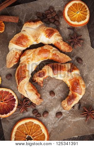 Fresh home made croissants with spices and dried fruit