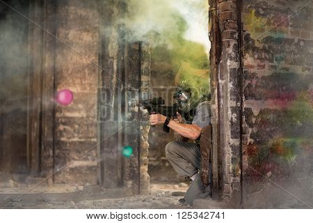 Paintball team in fortification during game