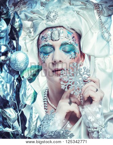 Winter beauty woman. Holiday makeup. Winter Queen with snow and ice hairstyle
