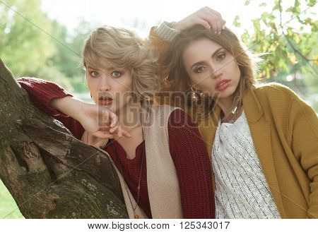 fashion women posing together outdoor