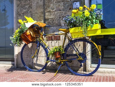 beautiful floral street decoration with old bisycle of postman