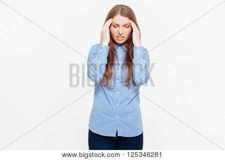 Young woman having headache isolated on a white background