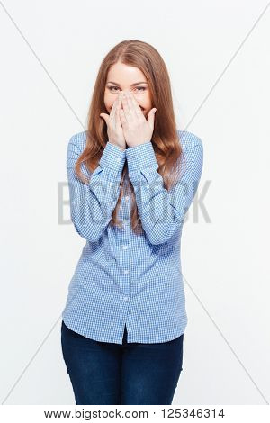 Laughing woman covering her mouth isolated on a white background