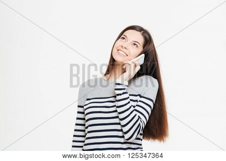 Smiling woman talking on the phone and looking up isolated on a white background