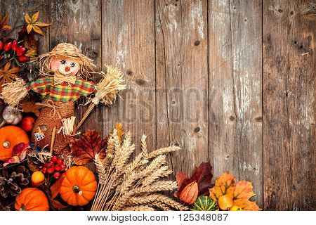 Colorful autumn background with a scarecrow decoration for Halloween and Thanksgiving