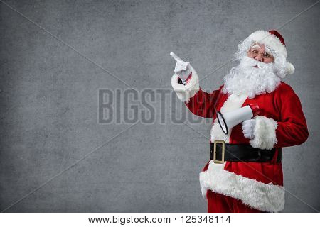 Santa Claus with a megaphone pointing in blank sign