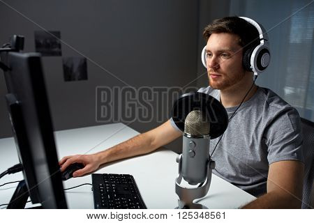 technology, gaming, entertainment, let's play and people concept - young man in headset with pc computer playing game at home and streaming playthrough or walkthrough video poster