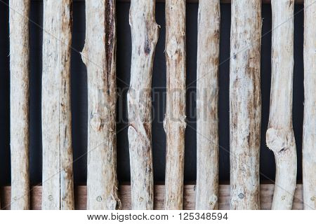backgrounds and texture concept - fence or shutters of wooden sticks