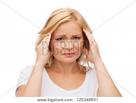 people, healthcare, stress and problem concept - unhappy woman suffering from headache