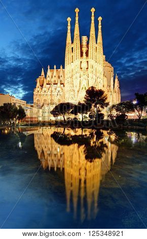 BARCELONA SPAIN - FEBRUARY 8: Sagrada Familia at night on February 8 2016 in Barcelona Spain. The impressive cathedral designed by Antoni Gaudi is being built since 1882 and is not finished yet