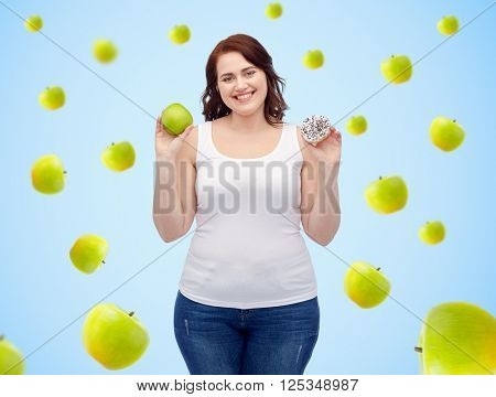 healthy eating, junk food, diet and choice people concept - smiling plus size woman choosing between green apple and donut over blue background