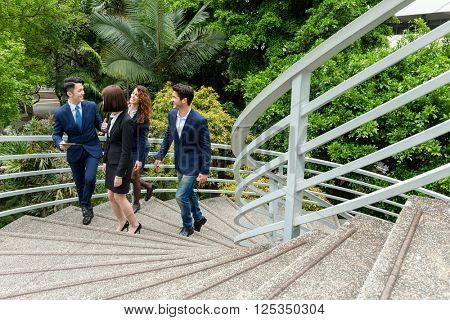 Group of business people discuss at outdoor