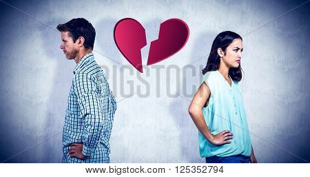 Frustrated couple ignoring each other against white background