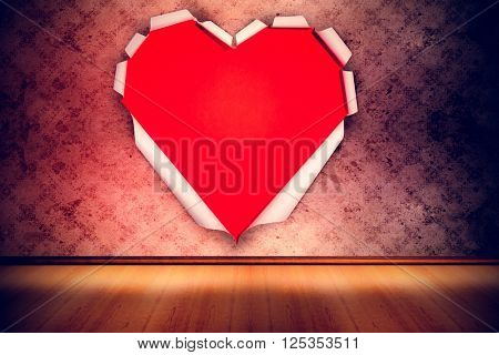White paper cut in heart shape against grimy room