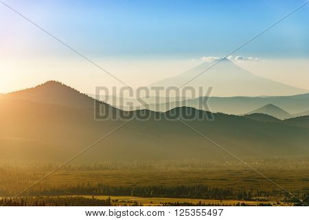 Mount Shasta in California seen from Lassen Volcanic National Park on a late July afternoon.