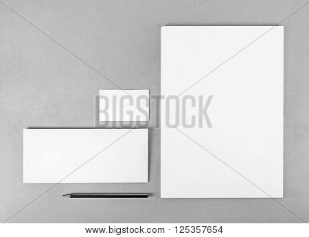 Photo of blank stationery set. Blank stationery template for branding identity for designers. Top view. Grayscale image.