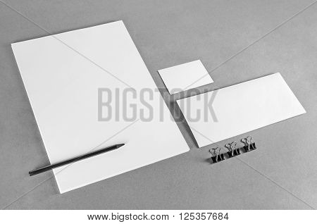 Blank stationery template on gray background. Photo of blank stationery set. Mock-up for branding identity. For design presentations and portfolios. Grayscale image.