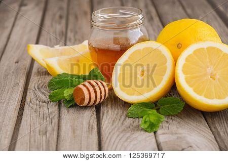 Ingredients for making lemonade - lemon, mint and honey, selective focus, copy space