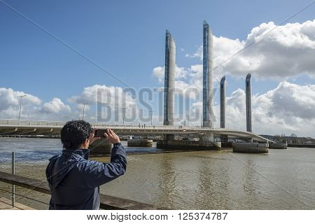 Bordeaux France - March 27 2016. Men photographing the Pont Jacques Chaban-Delmas in Bordeaux. Aquitaine. France.