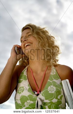 Portrait of a woman laughing at phone