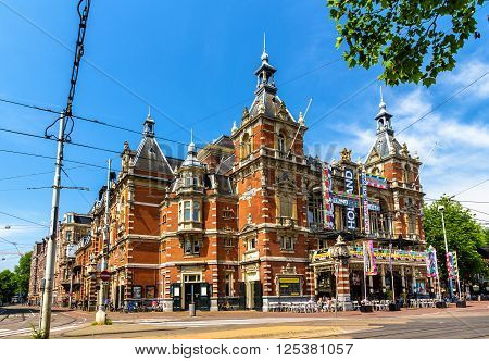 Amsterdam, Netherlands - June 9, 2014: View of Stadsschouwburg, the Municipal Theatre of Amsterdam. The building is in the neo-Renaissance style dating back to 1894.